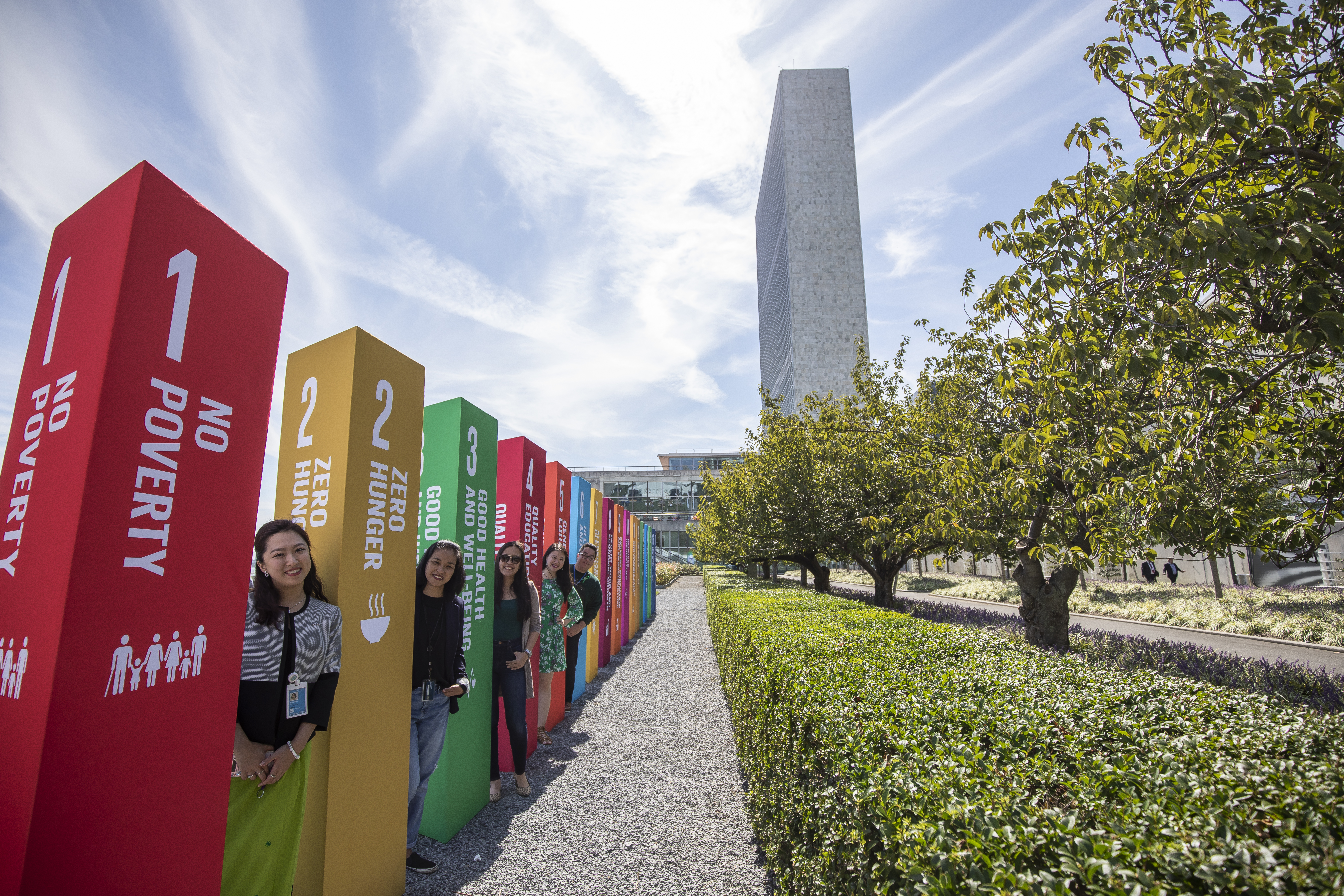 UN Staff members stand outside the SDG Action Zone by SDG pillars.
