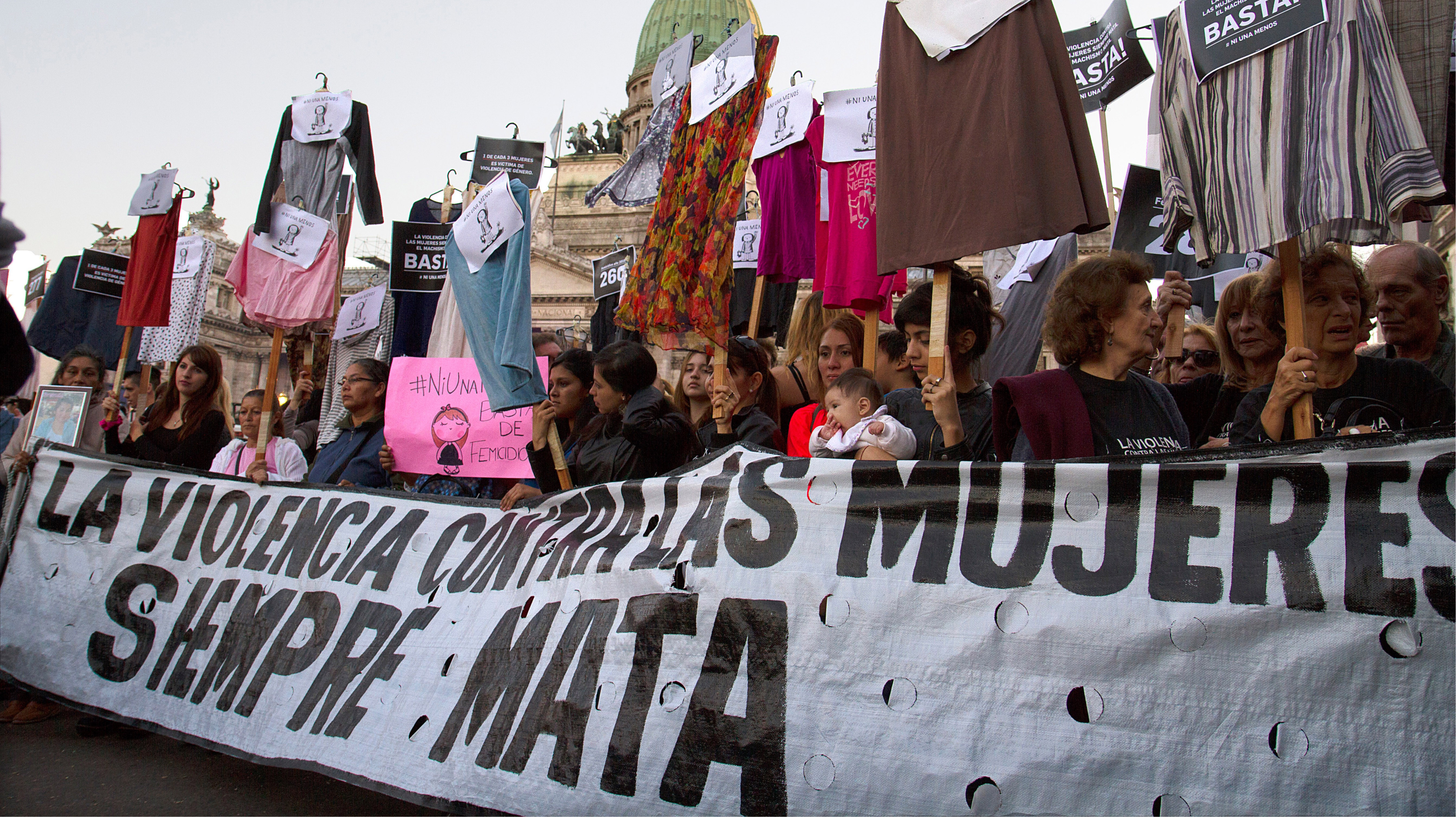Image shows women marching on the street in protest to the femicide occurring in the country.