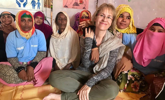 The UN Resident Coordinator in Bangladesh, Mia Seppo (centre), meets refugees in the west of the country in 2019.