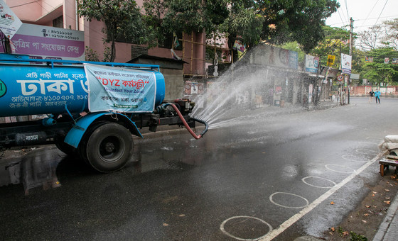 A municipal truck sanitizes the streets of Dhaka, Bangladesh in order to prevent COVID-19.
