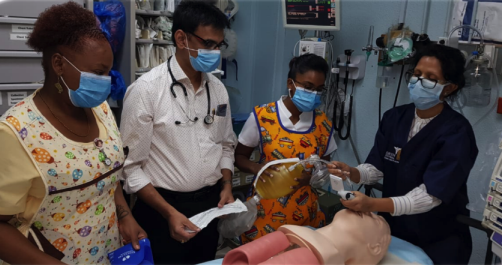 The image shows healthcare workers testing new lifesaving supplies procured by UNDP.