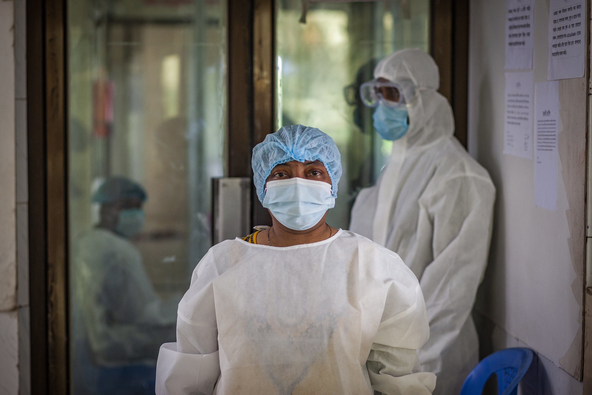 A cleaner waiting to begin her duty after getting disinfected at the Narayanganj-based Sajida Foundation hospital's isolation unit for coronavirus-infected patients.