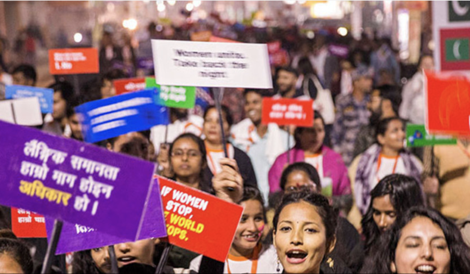 Photo shows young people holding up signs and protesting in Nepal.