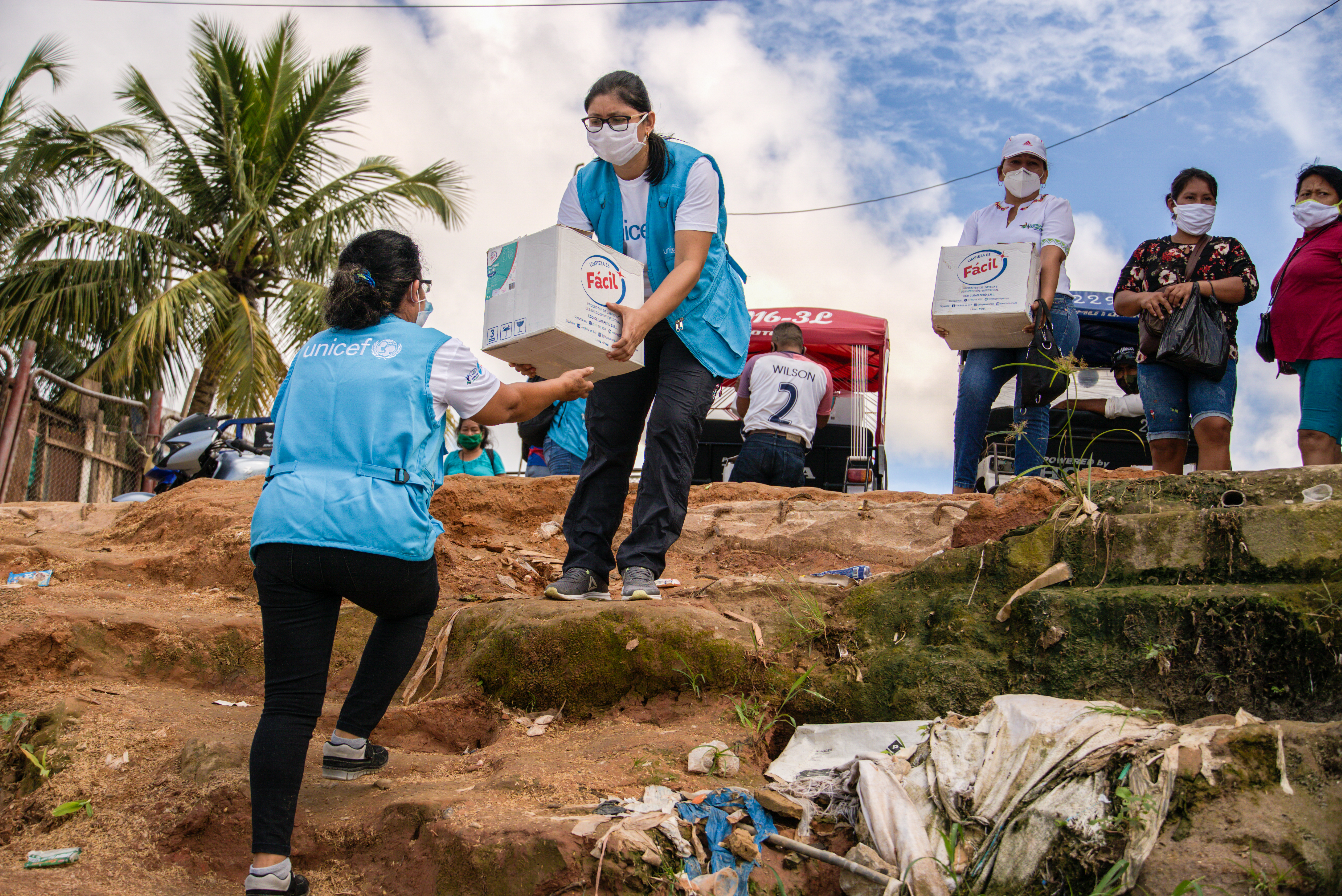UN Staff carry boxes of supplies to communities in remote areas of Peru.