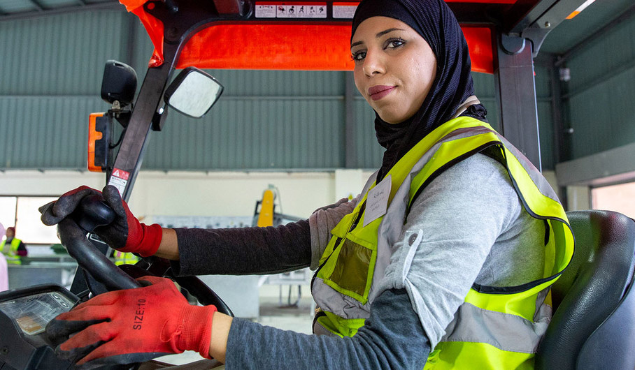 A woman drives a forklift truck at the recycling plant where she works in Northern Shouneh, Jordan.
