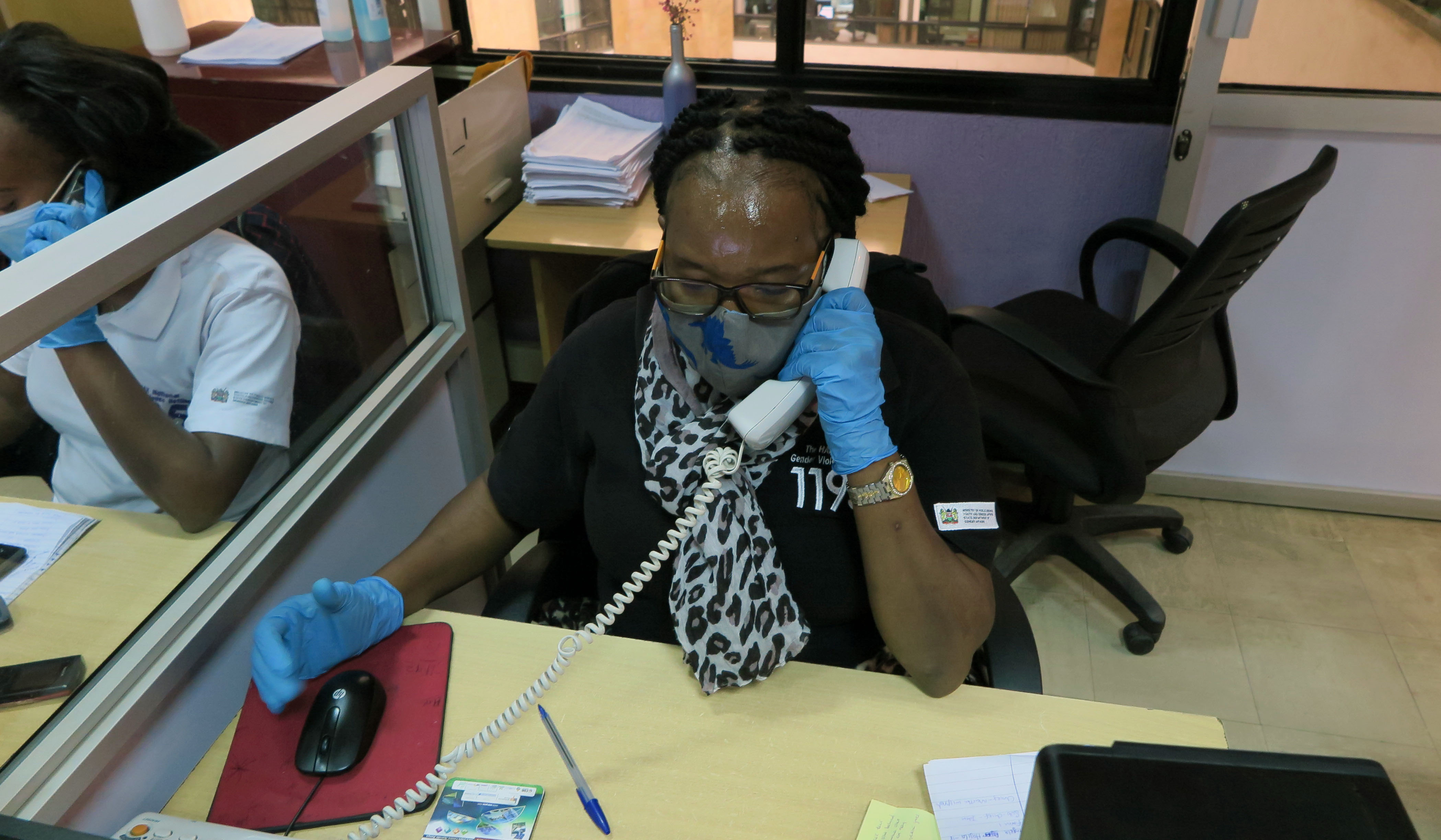 A tele-counselor, June (named change for privacy and protection), takes a call at the call centre.