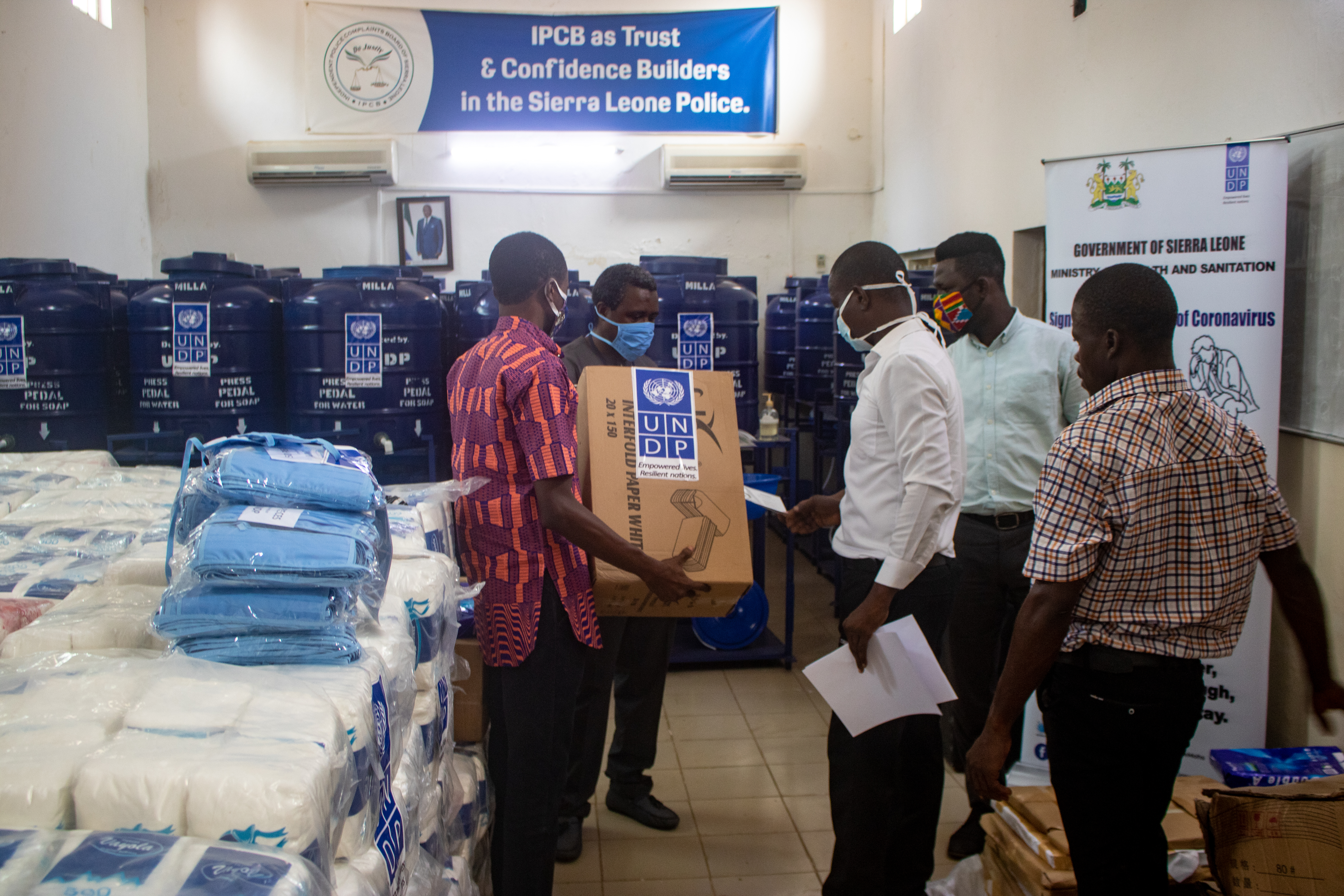 UNDP personnel with local government representatives take inventory of the essential supplies donated with support of UNDP.