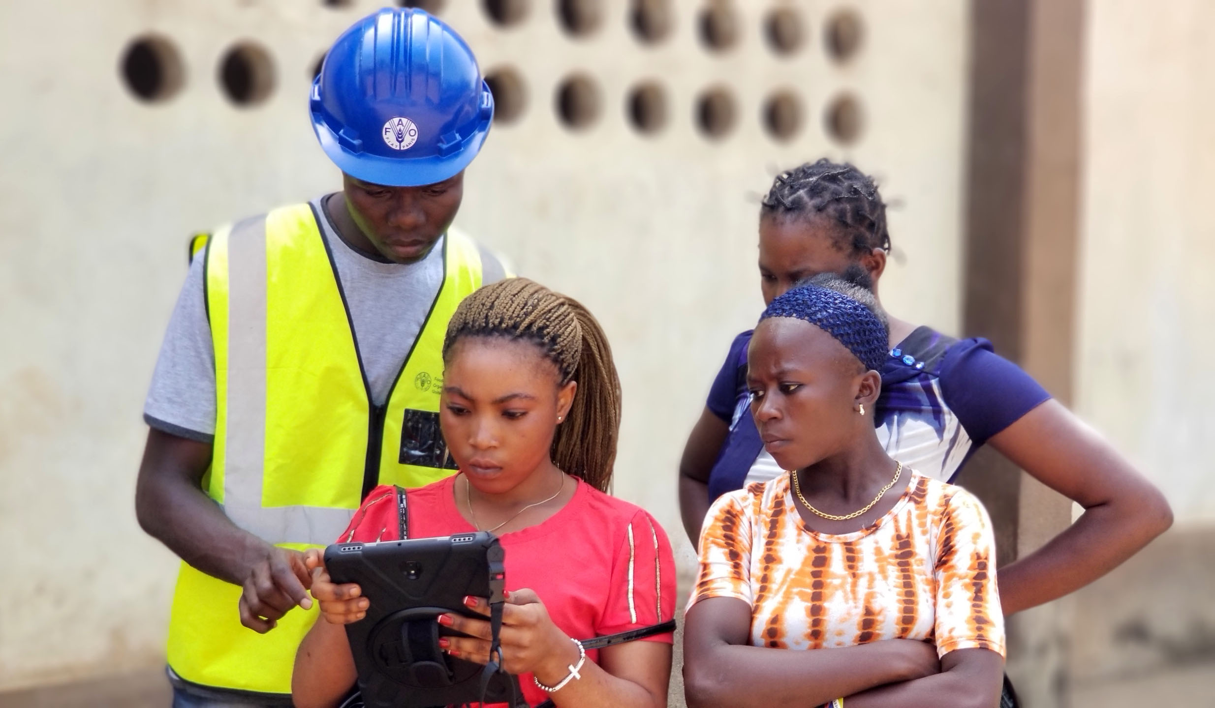 Young women are trained as para-surveyors to map family and village land boundaries. (Please note image was taken prior to COVID-19 social distancing measures were in place.