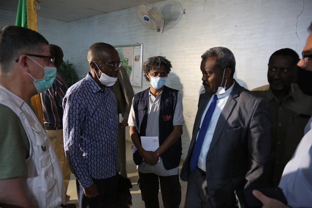 UN Resident Coordinator of Sudan, Babacar Cissé with UN staff members and the camp's security team lead, Wali