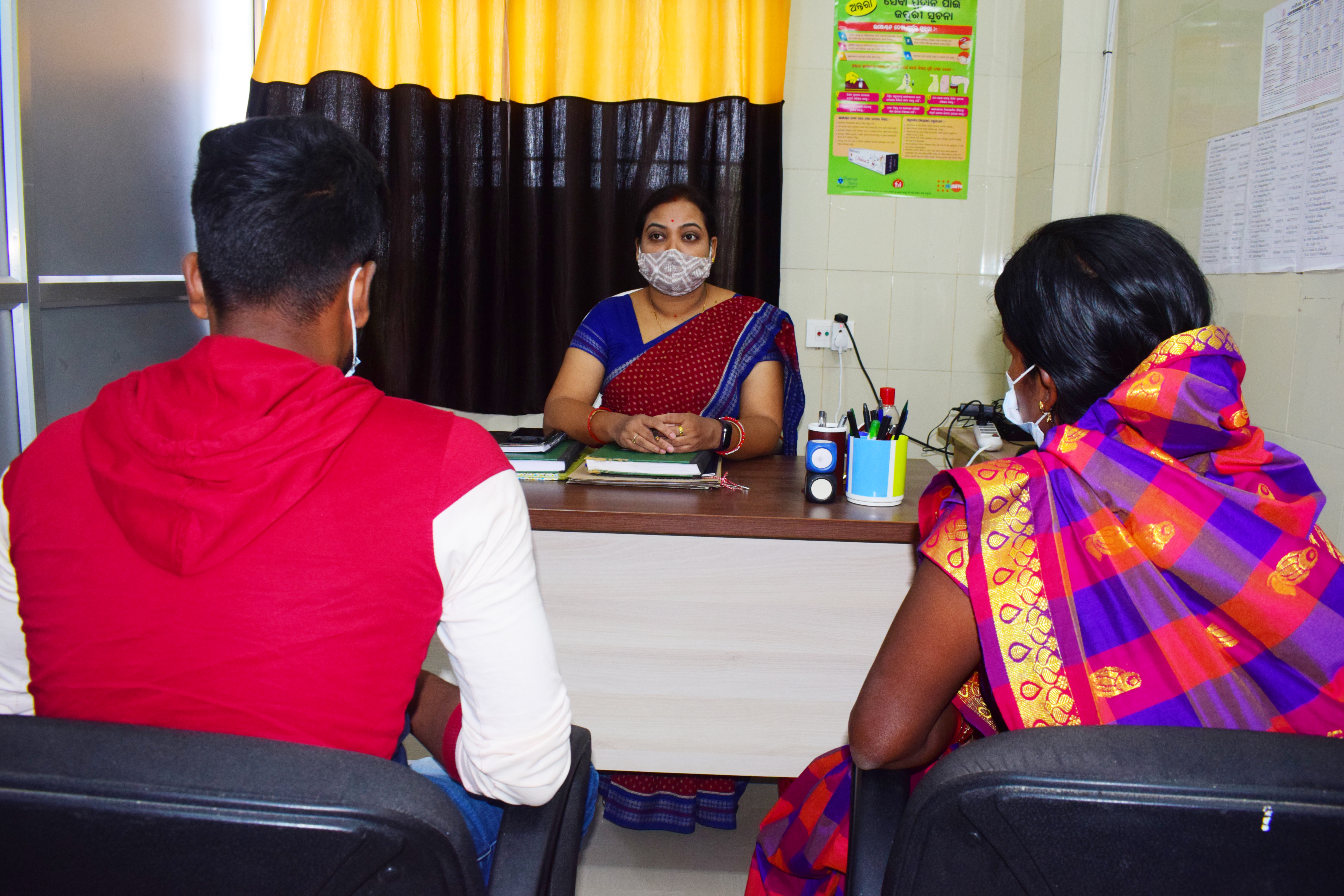 One of the healthcare workers trained to counsel speaks with clients at their office.
