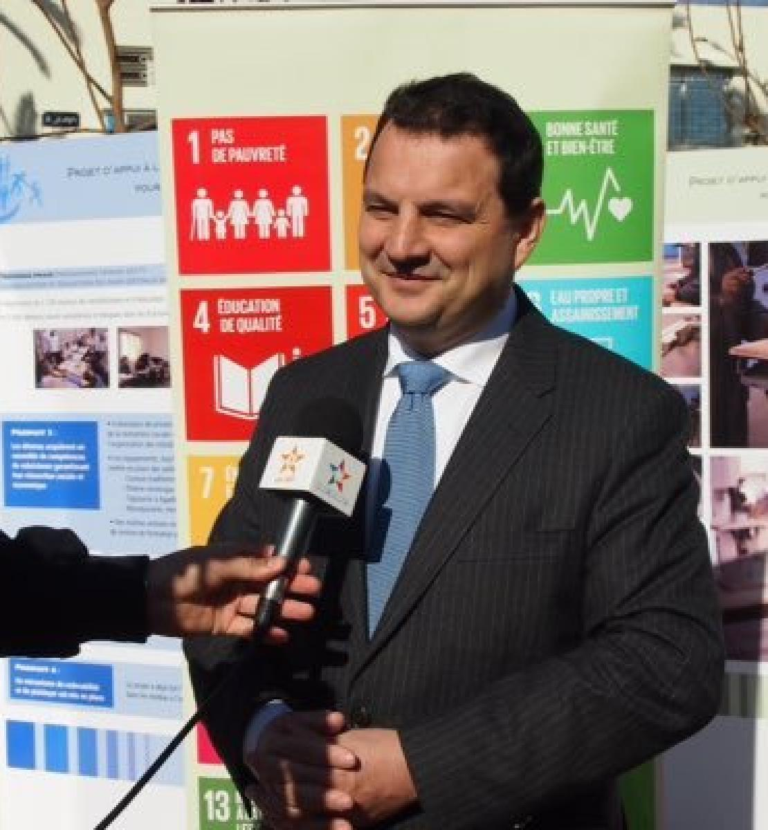 Image shows Philippe Poinsot being interviewed in front of an SDG banner
