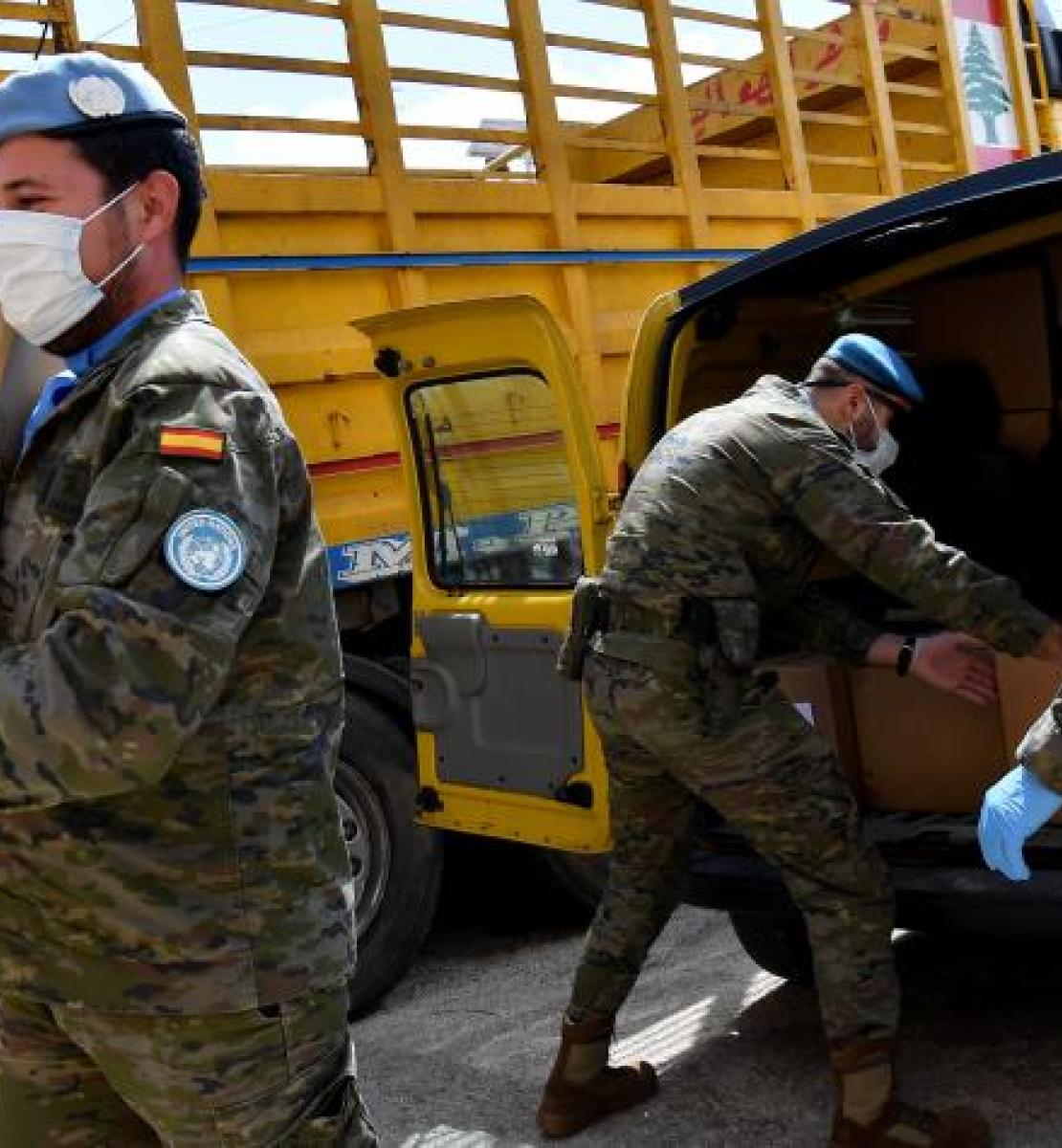 United Nations Interim Force in Lebanon unload a truck full of lifesaving supplies.