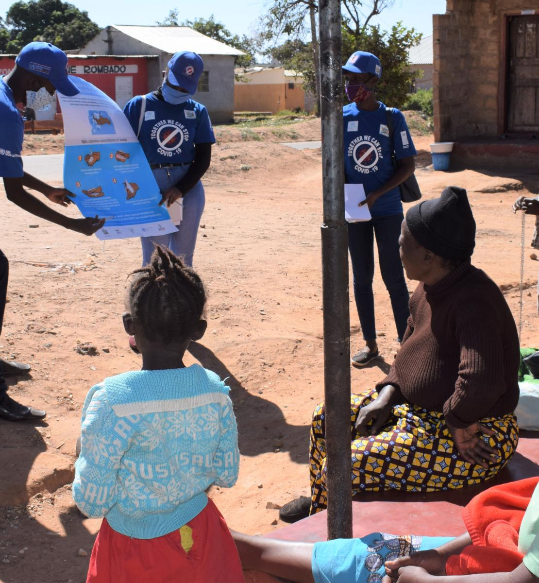 Community volunteers in Lusaka speaks to community members about COVID-19 as part of community sensitization on the virus.