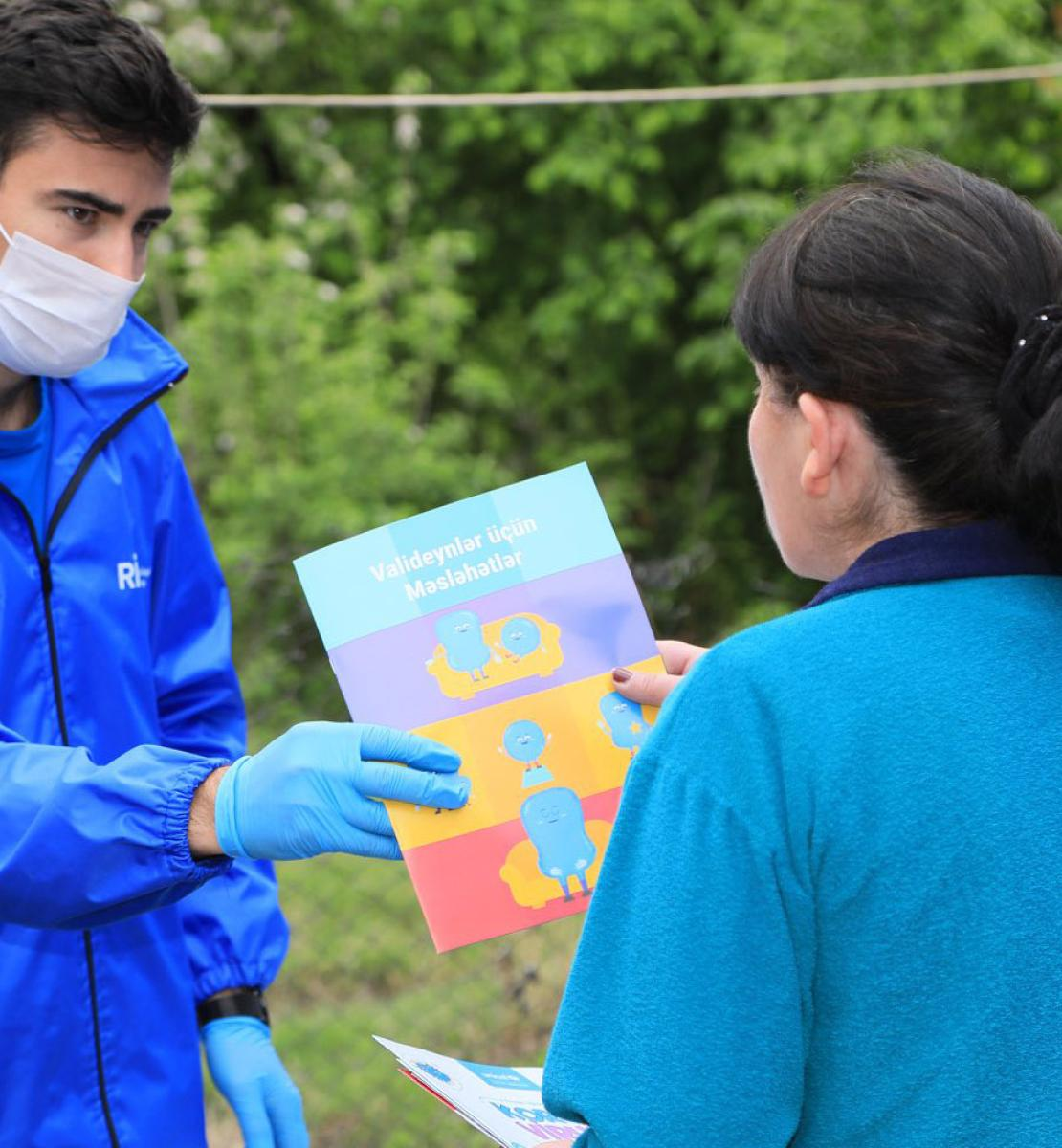 Dedicated volunteers provide COVID-19 awareness-raising material to help the community prevent the spread of the virus/