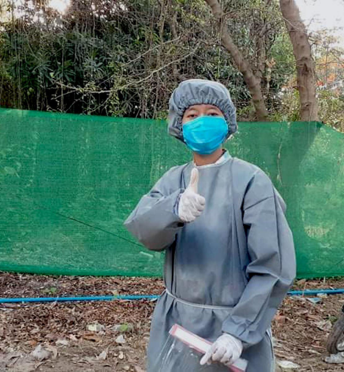 Min Min at the quarantine centre in Pyay wearing full personal protective equipment.