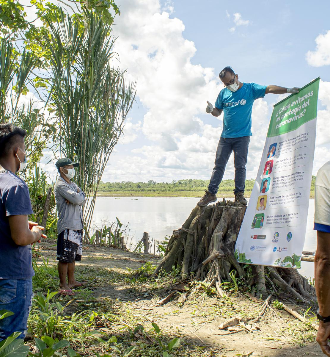 Fredy Vargas, UNICEF Community Engagement Consultant, discusses safe hygiene practices with indigenous community leaders in the Peruvian Amazon.