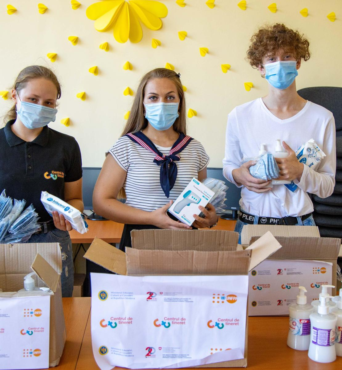 Youth volunteers organize supplies for distribution.