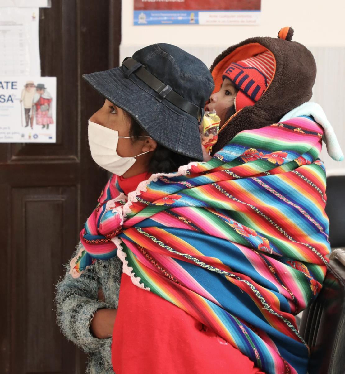 Photo of a Bolivian woman and a child waiting at a local health centre