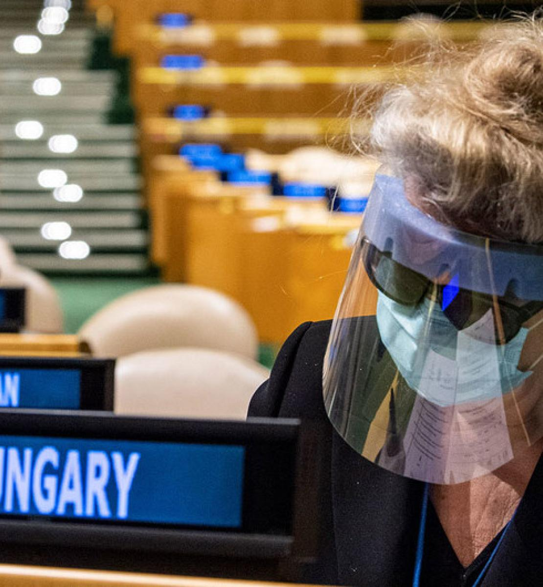 Katalin Bogyay, Permanent Representative of Hungary to the United Nations, prepares her ballots during the elections in an empty General Assembly Hall.