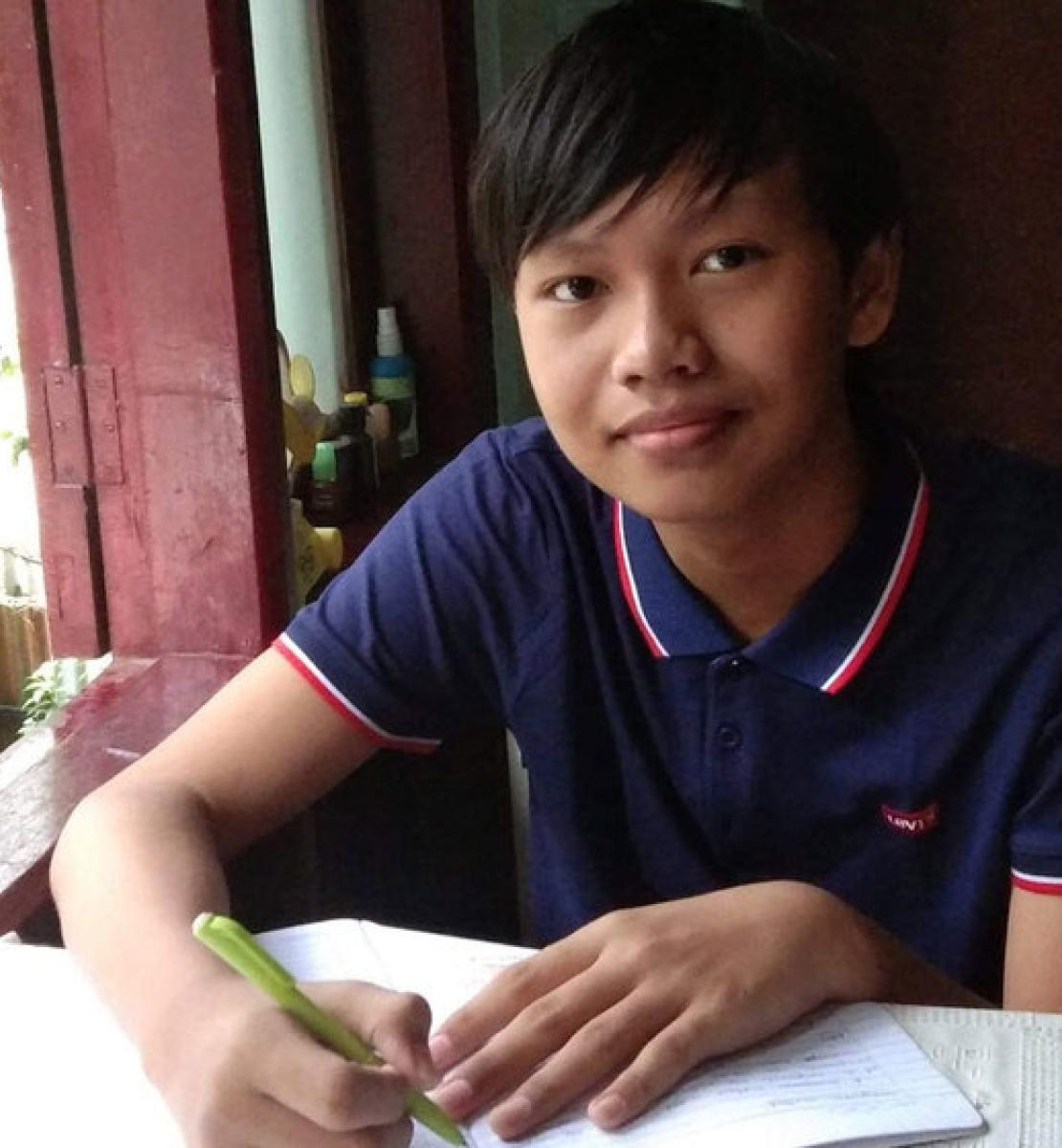 Thaw Lay, grade 10, from Yangon, Myanmar is shown studying at his home.
