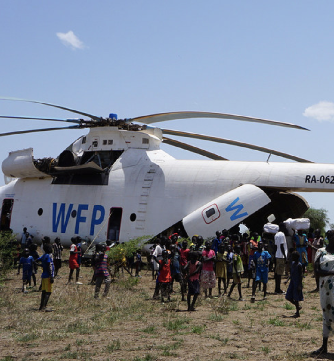 A UN World Food Programme (WFP) helicopter delivers much-needed supplies to  people in Udier, South Sudan.