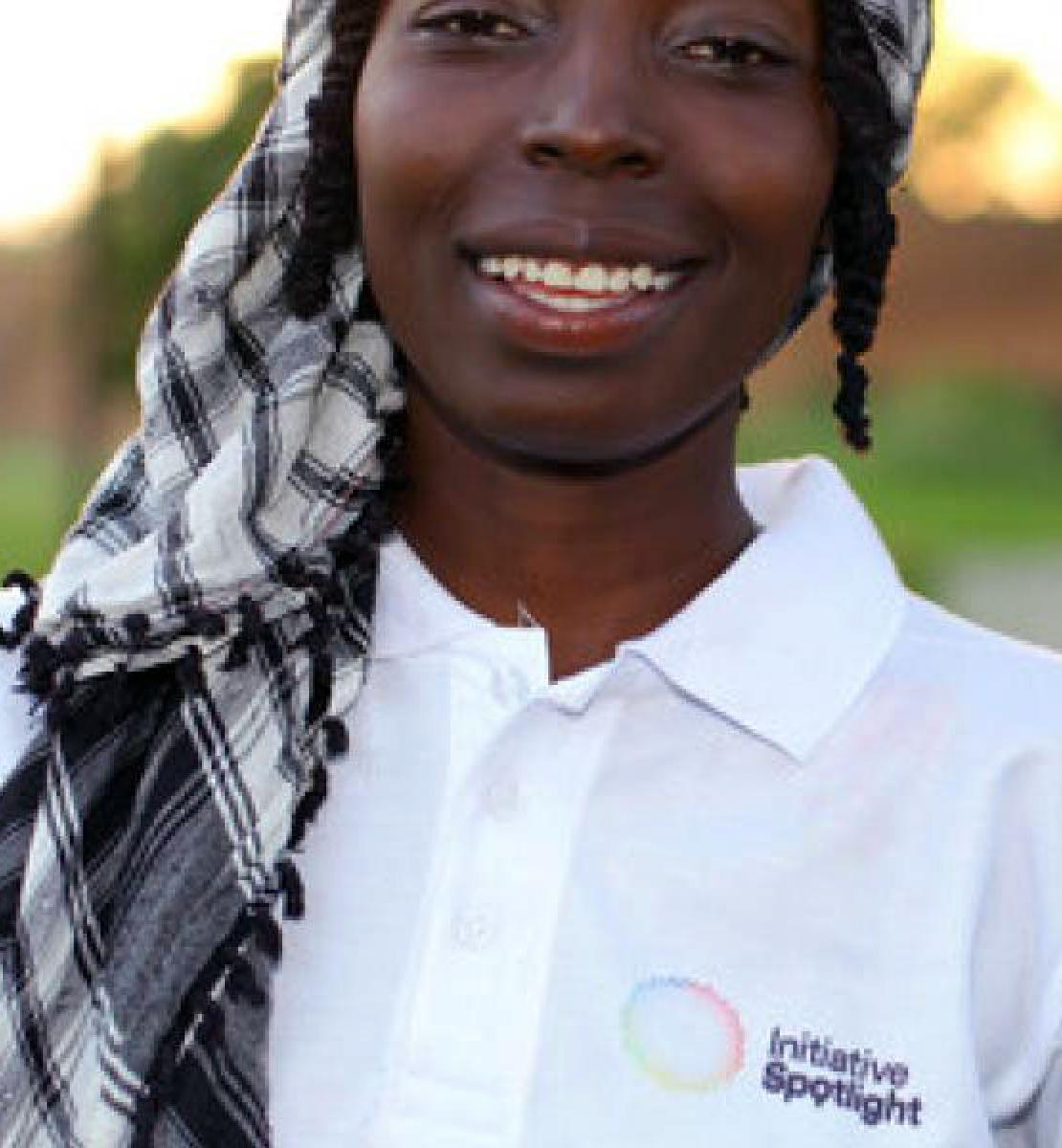 Photo of poet, Hama Daouda  Fatouma, wearing a white polo Spotlight Initiative shirt.