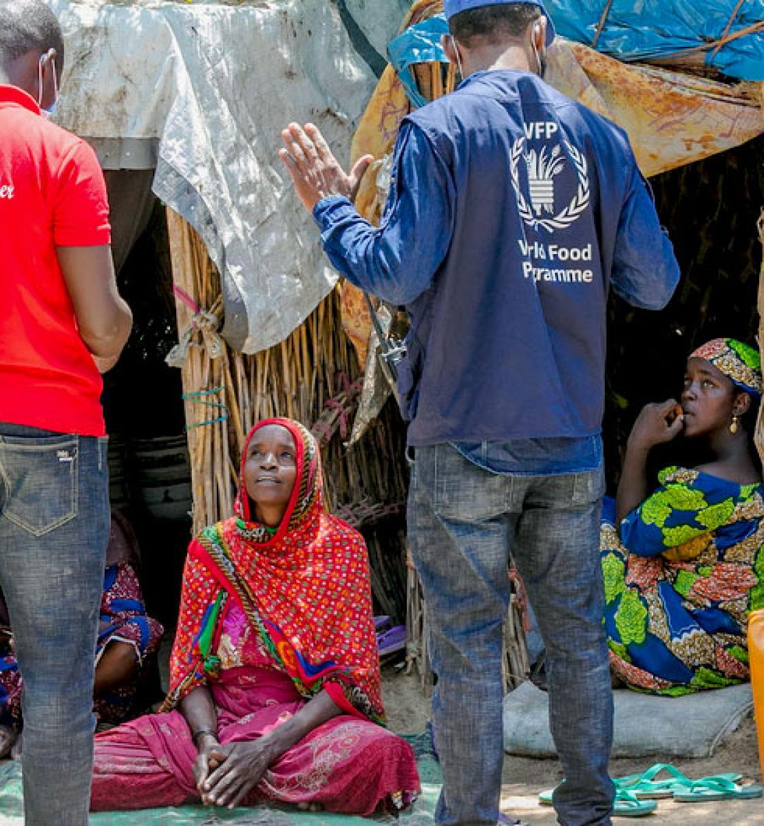 Pictured here, a WFP staff member interviews displaced persons at an informal IDP settlement in Maiduguri, Nigeria.