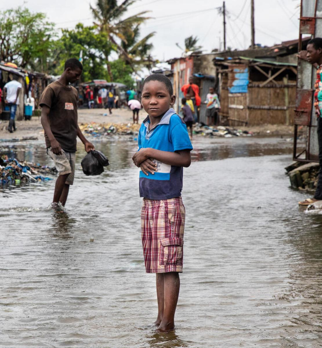 A child stands in rising water in the neighbourhood of Praia Nova in Beira, Mozambique.