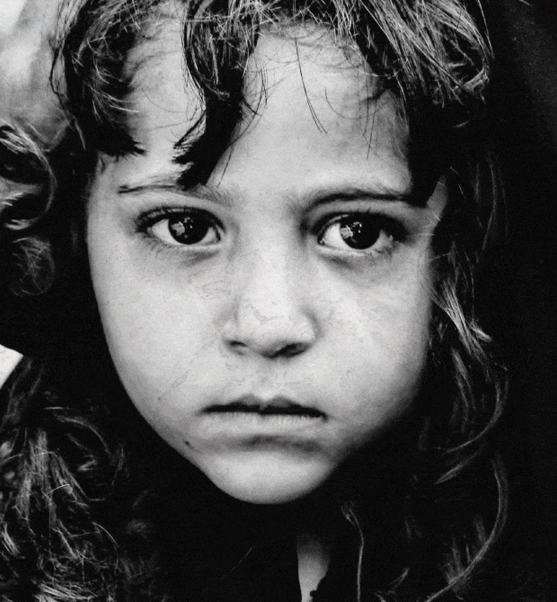 Close up black and white image of a little Yemeni girl.