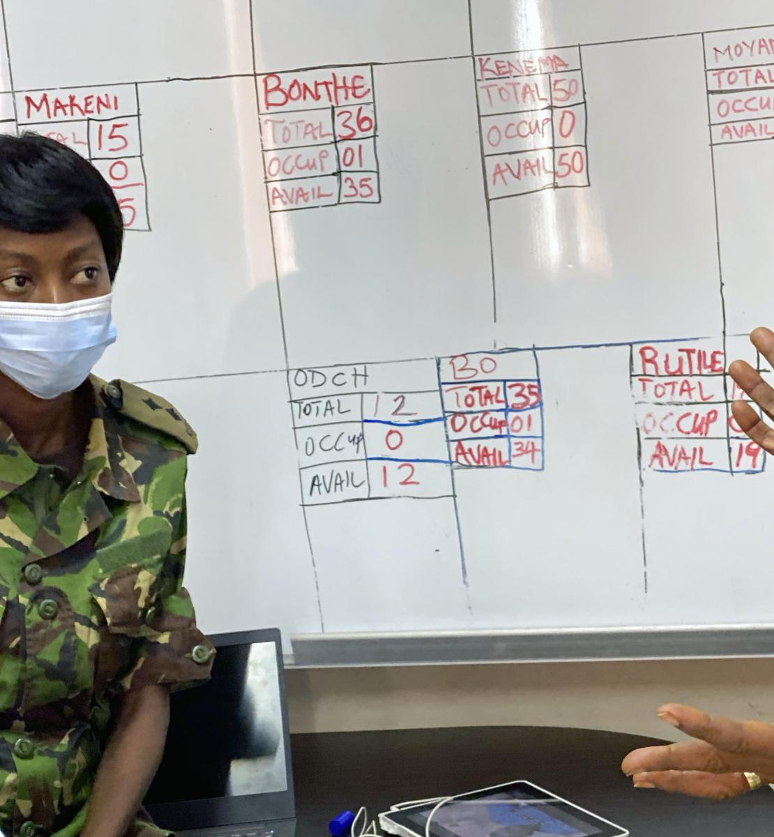 Lt. Moiwo and her colleague discuss the case management dashboard.
