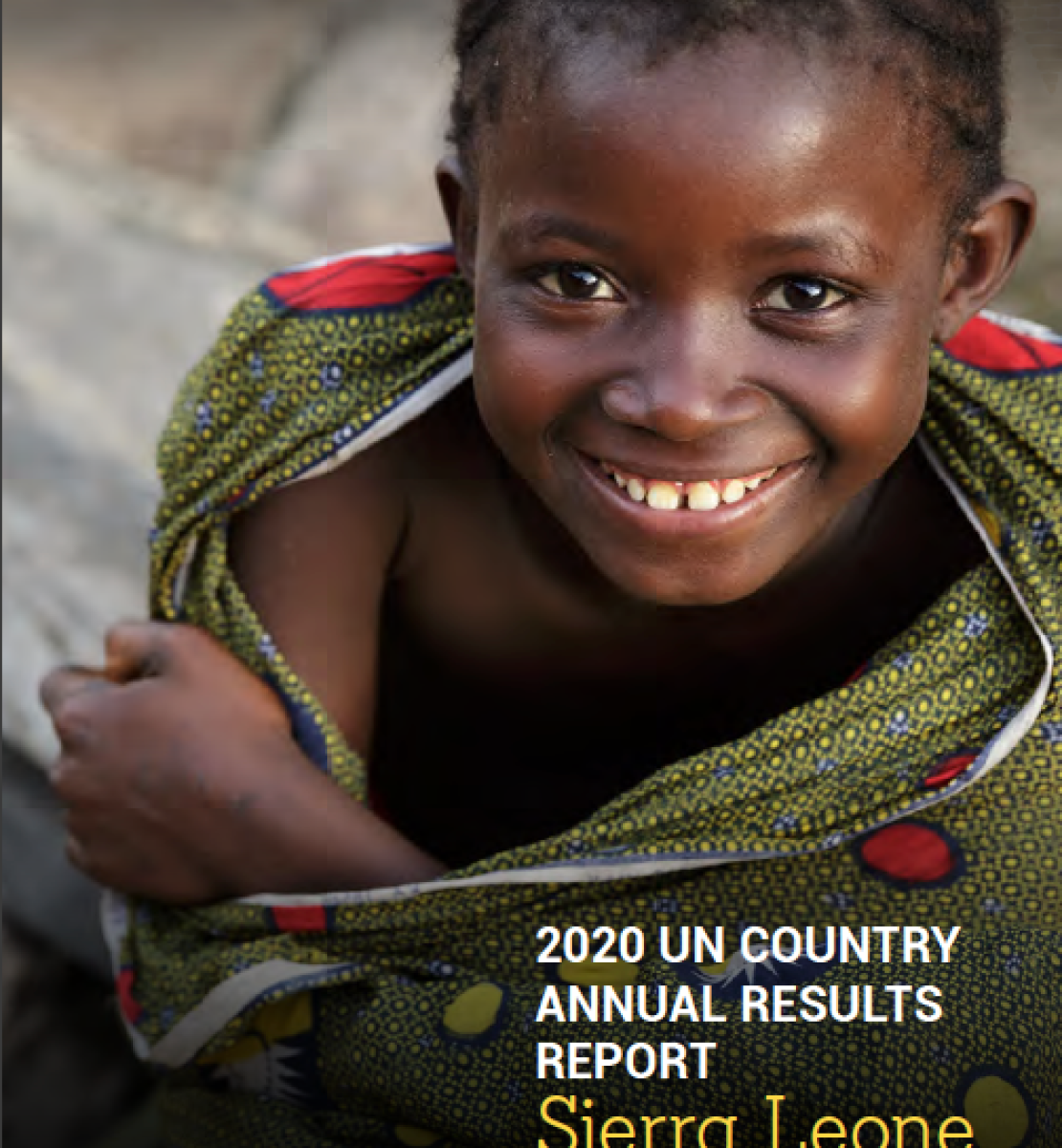The cover shows a beautiful young girl wrapped in a colourful, mostly green fabric as she smiles up at the camera with the title of the report at the bottom right corner.