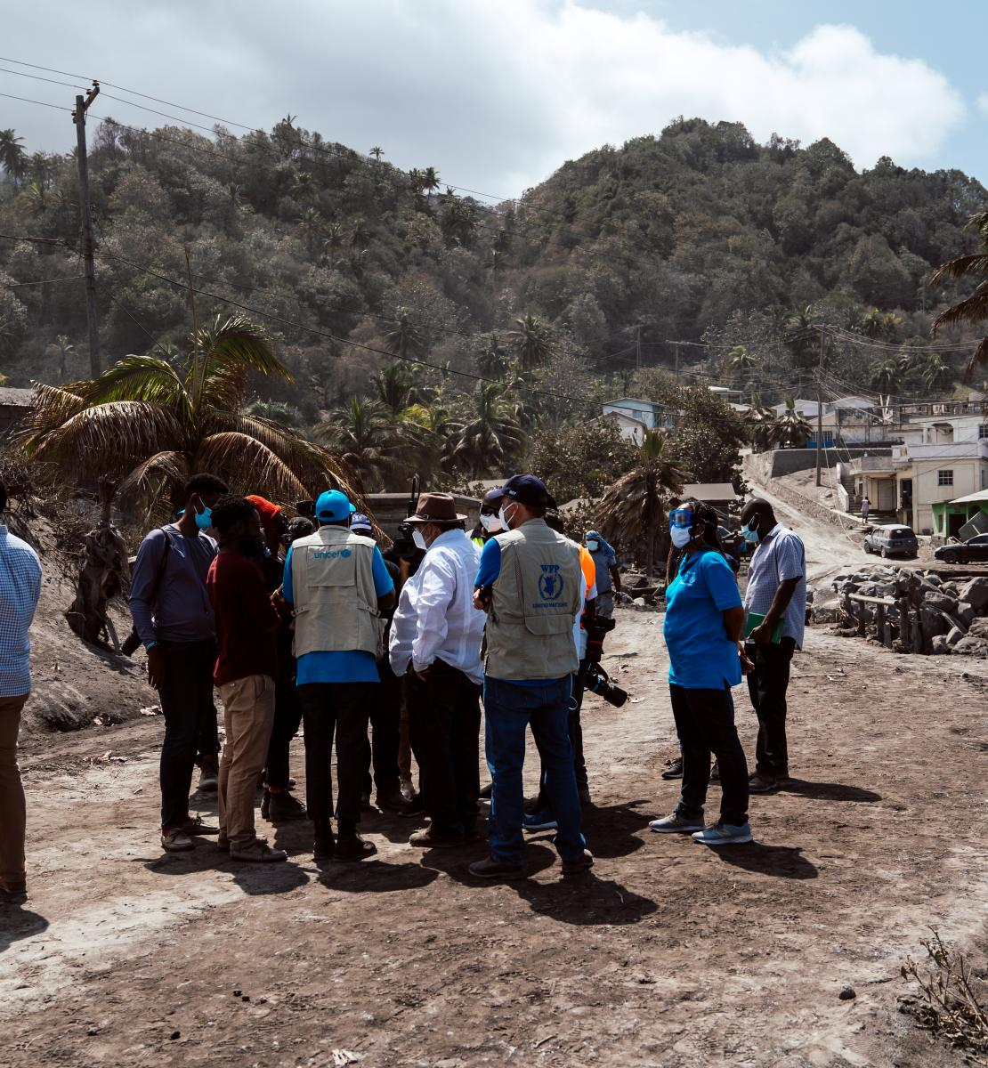 UN officials survey the aftermath of the volcanic eruption.